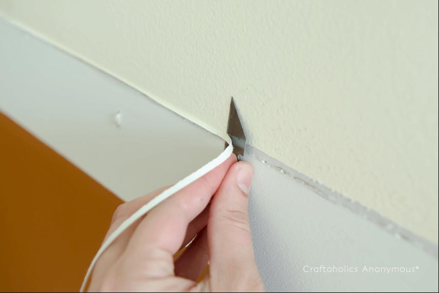 Réparer un mur avant peinture